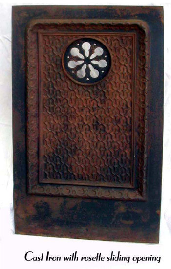 Cast iron architectural element with rosette swinging door.